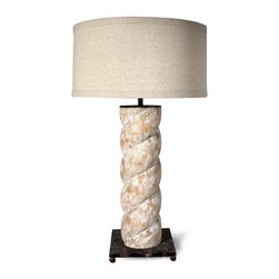 Bernal Lamp - There is about it a touch of the nautical; its rope-inspired column suggesting the impressive fittings of a ship that has embarked on journeys to faraway oceans and far-flung shores. With a soft faux finish of white and terra-cotta, the Bernal Lamp features platform of ebony-bronzed iron with petite feet; a generously sized drum shade in fresh beige completes the look.