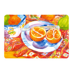 Caroline's Treasures - Florida Oranges Sliced For Breakfast  Kitchen Or Bath Mat 24X36 - Kitchen or Bath COMFORT FLOOR MAT This mat is 24 inch by 36 inch.  Comfort Mat / Carpet / Rug that is Made and Printed in the USA. A foam cushion is attached to the bottom of the mat for comfort when standing. The mat has been permenantly dyed for moderate traffic. Durable and fade resistant. The back of the mat is rubber backed to keep the mat from slipping on a smooth floor. Use pressure and water from garden hose or power washer to clean the mat.  Vacuuming only with the hard wood floor setting, as to not pull up the knap of the felt.   Avoid soap or cleaner that produces suds when cleaning.  It will be difficult to get the suds out of the mat.