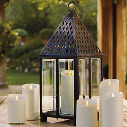 Trident Outdoor Lantern - This elegant brass lantern can work for both outdoor and indoor settings. I like its clean lines.