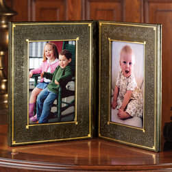 """Exposures - Leather Book Photo Frame - Overview With the classic appeal of a first edition bound book, this hand-tooled leather photo frame opens to display two photos. Embossed using handmade dies and treated to create a lovely antiqued finish, its leather cover is reminiscent of the days when precious portraits were housed in lavishly adorned cases. Display open to reveal photos, or display closed on a side table as a """"book"""" that offers a special surprise when opened. Makes a wonderful gift for book collectors and avid readers.   Features Dark green-brown leather  Gold tooling  Hand-tooled leather spine  Holds two vertical photos    Specifications  Measures 7"""" wide x 8 1/2"""" high"""