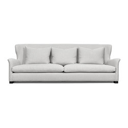 Wingback Sofa - Tailored but with an air of casualness, this sofa would be ideal in a farmhouse.