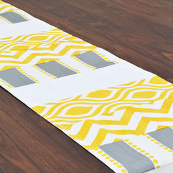 Triple Trend Table Runner - Love your table, but want to change things up a bit? Try this bright, bold table runner, which livens up your tabletop while still displaying its construction. Trendy shades of yellow and gray splash across the runner in wide stripes of zig-zag, trellis pattern, and contrast stripes for a fashionable, textural pop.