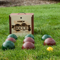 St. Pierre - St. Pierre Tournament 107mm Bocce Set in Wood Box Multicolor - TB2 - Shop for Backyard Games from Hayneedle.com! Whether you're serious about bocce or just looking for a tournament-quality set at a reasonable price the St. Pierre Tournament Bocce Set might be just the thing. Here are some details to help you decide: This bocce set includes four dark green and four dark red bocce balls all measuring 107mm and with vintage-style etchings to distinguish teams. An easily visible 57mm yellow pallino makes this set practical for play in the backyard (even in tall grass) beach or local bocce court. The balls are crafted from thermo-set composition resin for increased durability and are manufactured to international specifications. Did we mention the St. Pierre is the official bocce set of the United States Bocce Federation? Well maybe we did but that's just one of those things worth mentioning twice. Another is the included wood bocce box which allows you to neatly pack up your set for transport or storage. It features a convenient handle for easy comfortable carrying.