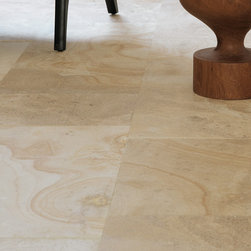 Royal Stone & Tile Showroom - Beaumaniere Classic is cut to accentuate the rich honey-coloured swirls that overlay the mottled taupe-grey tones of this classic French limestone.