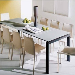 "Bontempi Casa - Telesio Dining Table - Designed by: Daniele Molteni Features: -Steel painted frame. -Sturdily constructed. -Top gloss extra glass. -Lightly padded / polyurethane seat. -Padded hide leather. -Made in Italy. Specifications: -Seat height: 19"". -Overall Chair Dimensions: 36"" H x 22"" W x 18.5"" D. -Overall Table Dimensions: 29.5"" H x 33.5"" W x 51.2"" D."