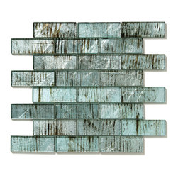 """Glass Tile Oasis - Wisteria Uniform Brick Blue Folia Brick Glossy Glass - Each sheet includes 8 rows of 3 tiles             Sheet size:  11.75"""" x 12""""        Tile Size:  4"""" x 1.5""""        Style:  Interlocking Tiles        Tile thickness:  1/4""""        Grout joints:  1/8""""        Finish:  Polished Colored Glass        Mounting:  Mesh Backed         Important Information:  During manufacturing  color is bonded to the back of the glass tiles. As a result  color may vary. Tiles should not be installed in areas exposed to direct sunlight as color will change.                                Sold by the sheet    -  Folia patterned-glass mosaics offer a unique appearance unachievable with conventional tiles. The vibrancy and depth of color combined with the reflective quality of glass results in a unique and dramatic effect that is borderline out-of-this-world! Glass tiles are suitable for both internal and external applications impervious to frost  sun light and water. They are easy to clean  maintain and never discolor. They will continue to provide a dazzling appearance for many years to come."""