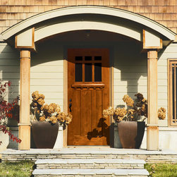 """GlassCraft's Craftsman Door in Mahogany wood - This Craftsman home is true to its simple, rustic and beautiful forms by featuring GlassCraft Door's Craftsman 6'8"""" tall door in Mahogany wood."""