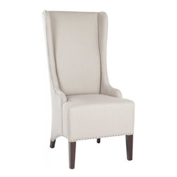 Safavieh - Dilettie Chair - The Dilettie Chair, in taupe linen fabric and cherry mahogany finished legs, absolutely commands attention. With a slightly tapered backrest, black flat nail head trim and sloping arms, the dramatic Dilettie Chair is all about smart sophistication.