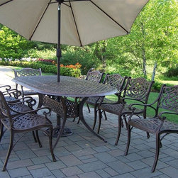 Oakland Living - Mississippi 9-Pc Traditional Outdoor Dining S - Includes one table, eight dining chairs, umbrella and umbrella stand. Fade, chip and crack resistant. Traditional lattice pattern and scroll work. Brass hardware. Warranty: One year limited. Made from rust free cast aluminum. Hardened powder coat finish in antique bronze. Minimal assembly required. Table: 84 in. L x 42 in. W x 29 in. H. Dining chair: 23 in. W x 22 in. D x 35.5 in. H (23 lbs.). Umbrella: 108 in. L x 108 in. W x 100 in. H (45 lbs.)This dining set is the prefect piece for any outdoor dinner setting. Just the right size for any backyard or patio. The Oakland Mississippi Collection combines southern style and modern designs giving you a rich addition to any outdoor setting.