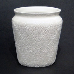 None - Saachi Waste Basket - This white waste basket will complement the decor in any bathroom. This elegant waste basket is constructed from 100 percent ceramic and features a paisley pattern done in an embossed texture for an added touch of depth and functional style.