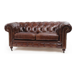 London Chesterfield Sofa - London Chesterfield sofa features the puffy and comfortable seating space in your home. Its vintage leather highlights the contemporary gaze. The sofa can easily suit your home decor and will make your guest feel comfortable.