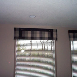 Valances by JH Interiors - Simple fabric valances that will work in any room, a distinctive silk plaid with button accents over white wood blinds keeps this space simple, uncluttered, and interesting.