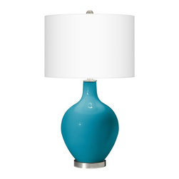 "Color Plus - Contemporary Caribbean Sea Ovo Table Lamp - Caribbean Blue Sea designer glass table lamp. White linen drum shade. Brushed steel finish accents. Takes one maximum 150 watt or equivalent bulb (not included). 28 1/2"" high. Shade is 16"" wide 11"" high. Base is 6"" wide.  Caribbean Blue Sea designer glass table lamp.  White linen drum shade.  Brushed steel finish accents.  Takes one maximum 150 watt or equivalent bulb (not included).  28 1/2"" high.  Shade is 16"" wide 11"" high.  Base is 6"" wide."