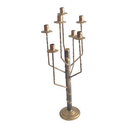 Handmade by artist - Table candelabra - A star filled sky, fine wine and dinner by candlelight is a recipe for romance. Start your perfect night with this stunning candelabra on the table. Designed by artist Joseph Tubman, the handmade candleholder is masterfully created to provide just the right ambience for a modern rendezvous.