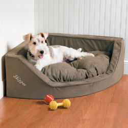 Grandin Road - Luxury Corner Dog Bed - Generous portions of ultra-comfortable polyester fill. Luxuriously thick microsuede cover zips off for cleaning. Tufted detailing of the removable pillow keeps the cushioning from clumping together. Add your pet's name in up to ten block-style letters (personalized items are non-returnable). Use the Personalized Corner Dog Bed to transform an underutilized corner area into your loveable hound's personal hideaway. Its space-saving design gives your pet his own space, without invading yours. . . . Add your pet's name in up to ten block-style letters (personalized items are non-returnable). Made in USA. Machine-washable.