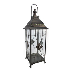 Zeckos - Decorative Metal and Glass Tabletop Candle Lantern 26 Inch - This decorative lantern is a beautiful accent to tables or shelves in your home or on your porch or patio. Made of metal, with glass sides, it measures 26 inches tall and has an 8 inch by 8 inch base. The lantern also has a metal hanger at the top, so it could be hung with a decorative chain or from a wall bracket, but hanging hardware is not included. It can accommodate candles up to 14 inches tall and 6 inches in diameter. A fun alternative to traditional candles is battery powered LED candles with timers, for worry-free accent lighting. The lantern also looks great with a string of battery powered LED lights placed in it. This lantern is a great addition to your home, and makes a lovely gift.