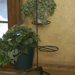 J & J Wire - J & J Wire Triple Plant Stands - Set of 2 Multicolor - 3073 - Shop for Caddies and Stands from Hayneedle.com! Turn six of your favorite houseplants into a pair of decorative trees with the J & J Wire Triple Plant Stands - Set of 2. Each plant stand has three platforms fanned out around the center pedestal. The wide sturdy base prevents tipping and the signature forged knot on top was designed exclusively by our expert blacksmiths. Proudly made in the USA from wrought iron with a black powder-coat finish these freestanding plant stands create a custom look in any setting. Each stand arrives in two pieces which easily slide together for fast assembly.About J & J Wire Inc.Located at the Industrial Park in Beatrice Nebraska J & J Wire Inc. started 25 years ago as a wire-forming business manufacturing mostly houseware items. Since then the company has grown into a metal fabrication business serving customers in many different manufacturing sectors in the United States and Canada. From quilt racks to wine racks J & J Wire is committed to creating handmade works of art at affordable prices.