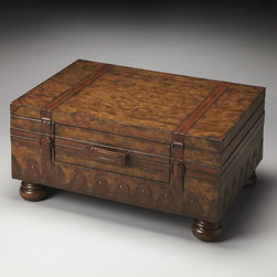 Butler - Butler Trunk Coffee Table - Heritage Multicolor - 0576070 - Shop for Tables from Hayneedle.com! Get the look of a well-traveled steamer trunk with the Butler Trunk Coffee Table - Heritage. This wooden trunk features an old world map glazed and lacquered surface with genuine leather appointments for worldly charm. Turned bun feet and a center drawer add style and storage.About Butler SpecialtyButler Specialty Company has been designing and manufacturing high-quality occasional and accent furniture since 1930. Each piece reflects Butler's dedication to enduring design exquisite craftsmanship and top-quality materials. This family-owned company is based in Chicago. They scour the globe in search of the finest materials and most efficient means of production reflecting their commitment to providing excellent quality at exceptional value.