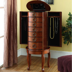"Powell - Jewelry Armoire in Burnished Oak - The ""Burnished Oak"" Jewelry Armoire is an elegant addition to any room. Six spacious drawers, a deep flip top storage space and two side storage cabinets concealed with doors provides ample storage for all of your bits and baubles. Graceful turned legs and open circular knobs accent the piece. Some assembly required. Features: -Burnished oak finish. -Ample storage space. -Graceful turned legs. -Open circular knobs accent the piece. -An elegant addition to any room. -Assembly required."