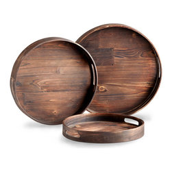 Dupre Circle Trays - Set of 3 - Wide planks of stained walnut wood, beautifully fitted together, provide the structure of the Dupre Circle Trays, a set of three wooden home accents with vertical walls for easy stacking, slot handles for convenient transport, and dark finish for a handsome, richly traditional impression. Use to enhance the utility of an upholstered ottoman or to display a curated strewing of treasures.