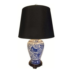 "Oriental furnishings - 24""H Blue and White Floral Painted Porcelain Table lamp - This 24""h. Asian blue and white floral painted table lamp has a contrasting black shade that adds contrast and a modern touch to a traditional design. Our table lamp makes a handsome addition to any room; imagine them on night stands or end tables. It has a simple design with modern shade that makes a colorful statement in any room! And what a great price! Imagine a pair on your buffet or hall table."