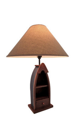 Wooden Row Boat Table Lamp with Shelves/Drawer 24 In. - This table lamp adds a wonderful accent to rooms with outdoorsy decor. It features half of a wooden row boat, with 2 small shelves and a small drawer for keepsakes. The lamp measures 24 inches tall, has a 6 1/2 inch X 4 1/4 inch base, and the coordinating linen shade measures 16 1/4 inches in diameter. The lamp uses a 40 watt (max) type A bulb (not included), and has a black 5 foot long power cord with a thumb wheel switch. Display a lucky fishing lure and special stones or shells from a trip on the shelves for a customized look to this lamp. It makes a great gift for friends and family that is sure to be admired.