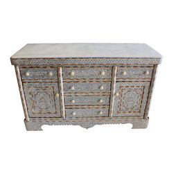 Badia Design Inc. - Moroccan Mother of Pearl Inlay Cabinet with White Marble Top - This is a very elegant and stylish Moroccan Mother of Pearl cabinet made of brown wood, white mother of pearl designs and comes with a white marble top. Cabinet has six working drawers and two side cabinet doors that will provide plenty of storage space. The sides are etched with an elegant floral design and inlaid with mother of pearl.