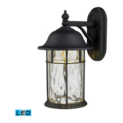 Elk Lighting - EL-42260/1 Lapuente 1-Light Outdoor Title 24 Compliant Led Wall Mount - The Lapuente Collection combines the latest in title 24 compliant LED technology with refined mission styling. A cast aluminum frame finished in matte black contrasts nicely with water glass that casts a soft, unobtrusive light.