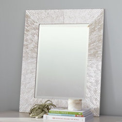 Miranda Capiz Mirror - This beautiful mirror almost feels like it is ensconced in ice. It would be perfect for making sure my stocking hat is on straight!