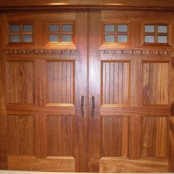 Custom Garage Doors - Window shelf design with dental molding and designer handles.