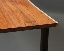 Acacia Dining Table - Dining table for San Francisco Mission district residence. Live-edge Acacia slab top with butterfly splint in Eastern Black Walnut and conversion varnish clear finish. Mild steel base with acid patina & clear finish.