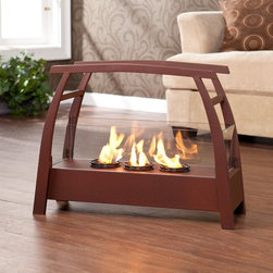 Southern Enterprises - Vasilis Portable Indoor/Outdoor Gel Fireplace - HN1219-6 - Shop for Fire Places Wood Stoves and Hardware from Hayneedle.com! Inside or out the Vasilis Portable Indoor/Outdoor Gel Fuel Fireplace warms up the decor - literally. It produces 9 000 BTUs of heat without smoke ash or odor while the gel fuel snaps and crackles like real wood. And don t forget the frame - it s made of metal tubing five-millimeter wire and a tempered glass cover to shield the flames. The powder-coat rust red finish highlights the sleek contemporary design.