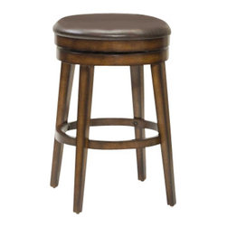 Hillsdale Furniture - Hillsdale Beech land Backless Swivel 26.5 Inch Counter Height Stool - Sometimes the simple and traditional ways are best and that is evident in Hillsdale Furniture's Beech Land swivel stool. A backless swivel stool with sturdy tapered legs and an ample brown vinyl seat this stool is taken from plain to posh by it's unique rustic oak finish. The warm tones and burnished edges add that extra wow to a stool that is a great fit for any bar area or kitchen. Constructed of sturdy hardwood with veneer.