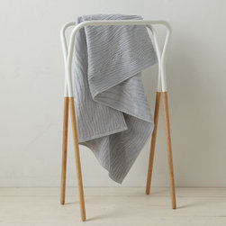 Modern Two-Tone Towel Rack - This is made for drying your towels, but I'm thinking it would be great in the living room to hang blankets on.