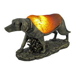 Zeckos - Bronzed Dog Accent Lamp with Amber Glass Shade - This lamp adds a wonderful accent to the home of loyal dog lovers. It features a detailed cold cast resin base with an antique bronze finish with a shade made of amber glass. The lamp measures 6 3/4 inches tall, 13 inches long, 4 inches wide, and has a black 5 foot long power cord with a rocker style on/off switch. The glass shade of the lamp casts an amber glow when lit, using a 15 watt (max) nightlight style bulb (included). The base has foam pads on the bottom of it to prevent scratching delicate surfaces, so you can display it on any table in your home. This piece also makes a great gift for dog loving friends.