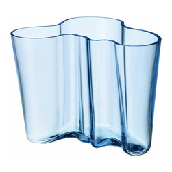 "Iittala - Aalto Vase 6.25"" Light Blue - The beautifully curved lines of this glass vase deserve to take center stage in your home. Fill the vessel with long-stemmed flowers or leave it empty, but find a place for this to be admired. Just imagine it elegantly anchoring your foyer or dining table."