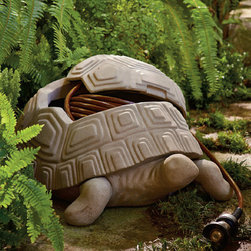 "Frontgate - Turtle Hose Pot - Crafted from all-weather faux stone. Drainage hole prevents standing water. Exit hole connects hose to spigot. Hose and Hose Nozzle sold separately. This whimsical faux-stone turtle conceals 100 ft. of 1/2 "" hose and adds a touch of enchantment into your garden or landscape.  .  .  .  ."