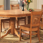 East West Furniture - Vancouver Oval Dining Table - Traditional design. Double pedestal. 17 in. butterfly leaf. Made from Asian solid wood. Oak finish. Assembly required. Minimum: 59 in. L x 40 in. W x 30 in. H. Maximum: 76 in. L x 40 in. W x 30 in. H