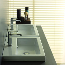 Tecla - Rectangular White Ceramic Self Rimming, Wall Mounted or Vessel Bathroom Sink - Rectangular white ceramic self rimming, wall mounted, or vessel sink. Washbasin comes with overflow and no hole, one hole or three hole options. Made in Italy by Tecla. Made out of white ceramic. Contemporary design. Includes overflow. Standard drain size of 1.25 inches. ADA compliant. Because the sink has multiple installations, the back side is not glazed.