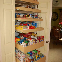 Pull Out Pantry Shelves - Make sure you can get to everything in your pantry.  Roll out pantry shelves from ShelfGenie of Kentucky are custom made to fit your existing cabinets and closets.