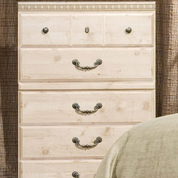 Standard Furniture - Seville 5 Drawer Chest - Simulated Jura granite top. Simulated carvings offer texture and richness to the design. Ample storage. Surfaces clean easily with a soft cloth. Drawers offer roller side drawer guides. Drawer stops are included for safety. Made from wood products with simulated wood grain laminates with metal grills. Bail pulls and knobs with simulated pewter color finish. Old fashioned wood color. 31 in. W x 15 in. D x 47 in. HSeville offers a warm blend of soft tones and granite color illustrate the European Country style of this collection