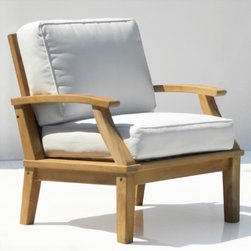 St. Barts Deep Seating Teak Arm Chair with Cushions - This single seating arm chair will become the center of attention in you outdoor retreat. Beautifully hand carved teak wood and outdoor cushions will provide the ultimate relaxation experience. Pair with other teak items to create your own poolside oasis.