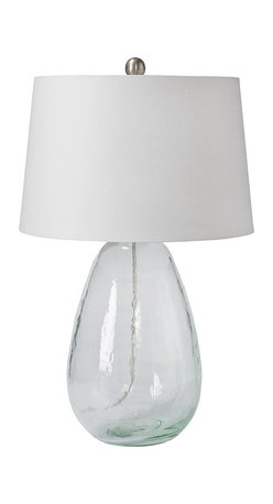 """Regina Andrew - Regina Andrew St. Barts Glass Table Lamp - A rounded glass base lends this Regina Andrew St. Barts table lamp clear and contemporary style. Paired with a white round shade, the light fixture illuminates side tables with refined panache. 15""""W x 15""""D x 24""""H; Glass; Accepts one 150W bulb (not attached); 3-way turn knob"""