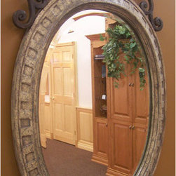 Ornate Beveled Mirror - Distressed - This beveled mirror has an beautiful, elegant style. The frame is sculpted cultured stone with an iron header.