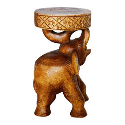 Kammika - Chang Stool 11 D x 20 inch H Sust Monkey Pod Wood in Eco Livos Walnut Oil Finish - Our Sustainable Monkey Pod Wood Elephant (Chang in Thai) Stool 11 inch diameter x 20 inch height with Eco Friendly Natural, Food-safe Livos Walnut Oil Finish presents a hand carved rendition supporting a round flat surface. This hand carved elephant stool can also serve as an end table or pedestal stand. Each is hand carved from a single piece of wood and finished with Livos Walnut Oil. Appealing to the viewer from any angle, each is more than a piece of furniture - it is a Work of Eco Friendly Functional Art! Craftspeople from the Chiang Mai area in Northern Thailand create these pieces with the simplest of tools. After each Monkey Pod Wood (Acacia, Koa, Rain Tree grown for wood carving) piece is dried, carved and sanded, it is rubbed in Livos Walnut oil that is polished to a matte finish. Color ranges from medium to dark Walnut brown tones that will darken as the wood ages. These natural oils are translucent, so the wood grain detail is highlighted. There is no oily feel; and cannot bleed into carpets, as it contains natural lacs. This eco friendly piece is made from the branches of the Acacia tree in Thailand - where each branch is cut and carved to order (allowing the tree to continue growing); we make minimal use of electric hand sanders in the finishing process. All products are dried in solar or propane kilns. No chemicals are used in the process, ever. We use only eco friendly, natural, and food-safe finishing oils. This item is packaged with cartons from recycled cardboard with no plastic or other fillers. As this is a natural product, the color and grain of your piece of Nature will be unique, and may include small checks or cracks that occur when the wood is dried. Sizes are approximate. Products could have visible marks from tools used, patches from small repairs, knot holes, natural inclusions or holes. There may be various separations or cracks on your piece when it arrives. There may be some slight variation in size, color, texture, and finish. Only listed product included.