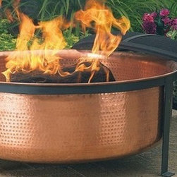 Hammered Copper Fire Pit - Earthy and sleek, this outdoor fire pit could take anyone's barbecue up a notch.