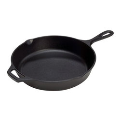 Lodge - Lodge Logic 10.25 / 12 in. Seasoned Skillet with Assist Handle - L8SK3 - Shop for Skillets & Fry Pans from Hayneedle.com! The Lodge Logic 10.25 / 12-Inch Seasoned Skillet with Assist Handle is an invaluable tool for any cook. The heat-retention qualities of this cast iron skillet allow for even cooking temperatures without hot spots. This skillet comes pre-seasoned with a special vegetable oil formula for your convenience and the coating is also non-stick for ease of use. The skillets measure either 10.25 or 12 inches in diameter with a depth of 2 inches; the assist handles make for easy transportation from stove to table.About Lodge ManufacturingFounded by Joseph Lodge in 1896 Lodge Manufacturing is the oldest family-owned cookware foundry in America and is a market leader in cast iron cookware. Nestled alongside the Cumberland Plateau of the Appalachian Mountains is the town of South Pittsburg Tennessee where Lodge produces the finest cast iron cookware in the world. The company offers the most extensive selection of quality cast iron goods on the market including skillets Dutch ovens camping cookware and more. Lodge is also an eco-responsible company with programs to reduce hazardous waste reuse foundry sand establish new ponds for plant and animal life and plant new trees on the Lodge campus.