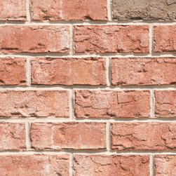 Triangle Brick's Key West - If you're looking for an exterior cladding option inspired by the vivid architecture of the Florida tropics, our Key West tumbled brick is the perfect choice. This soft salmon-colored brick provides a uniquely tropical feel to your building project, featuring subtle pink undertones and gray highlights for a look that's just as bright and sunny as it is peaceful and serene. The Key West brick is part of Triangle Brick Company's exclusive Premium product tier.