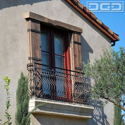 Custom Sliding Barn Door Shutters in Rustic Reclaimed Wood & Rustic Hardware - Newport Beach, CA - These custom designed and handcrafted sliding shutters seen on this balcony are made out of reclaimed, eco-friendly wood recovered from a centuries-old barn. The selected reclaimed wood species was oak because this species tends to show earthy brown colors that pulled the home's existing color scheme together with highlights that flow well with the terra cotta roof and plaster color.