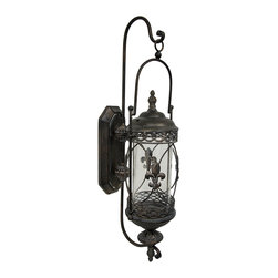 Zeckos - Large Rustic Fleur de Lis Glass and Metal Hanging Wall Candle Lantern - Add a touch of rustic charm to your home or sheltered patio, porch or garden oasis with this twisted design wall lantern Crafted from metal, it features a twisted metal design with Fleur de Lis accents that gives it an elegant antique feel, and a glass cylinder that houses up to a 4 inch diameter pillar style candle (not included). This 29 inch high, 8 inch wide, 10 inch deep wall sconce showcases the artistic melding of glass and metal that easily mounts to the wall using the attached hangers on the back. It's a wonderful housewarming gift for a friend sure to be enjoyed